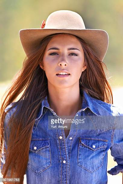 learning how to rough it! - cowgirl hairstyles stock photos and pictures