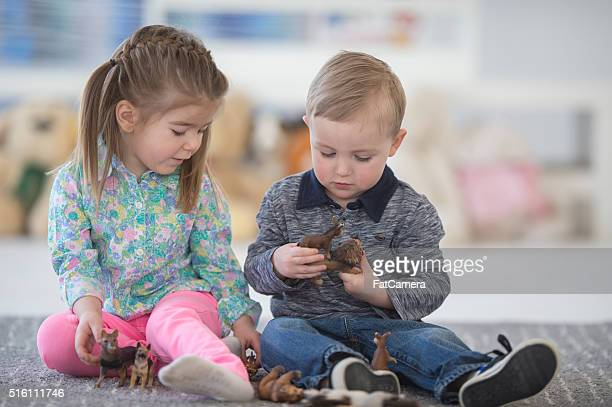 learning how to share toys - toy animal stock photos and pictures