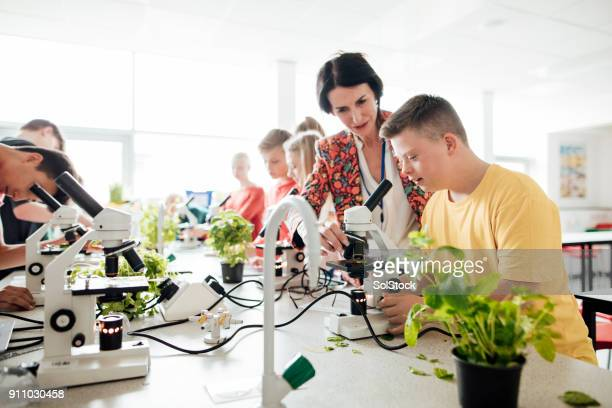 learning in the laboratory - down syndrome stock pictures, royalty-free photos & images