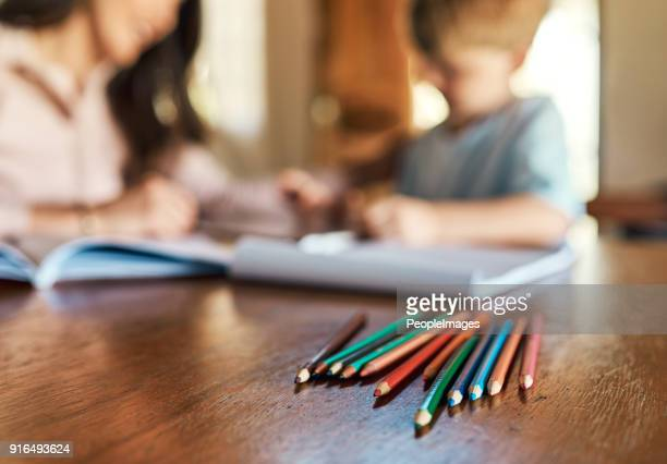 learning is a family affair - colouring stock photos and pictures