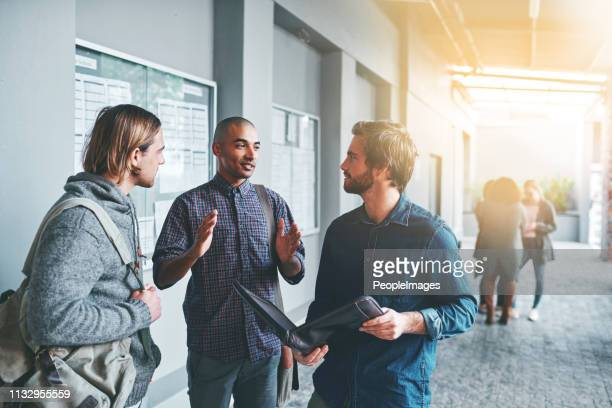 learning is better when we do it together - modern manhood stock pictures, royalty-free photos & images