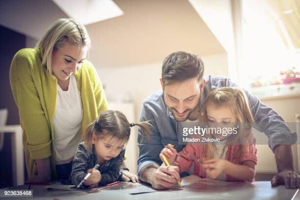 learning. - family at home stock photos and pictures