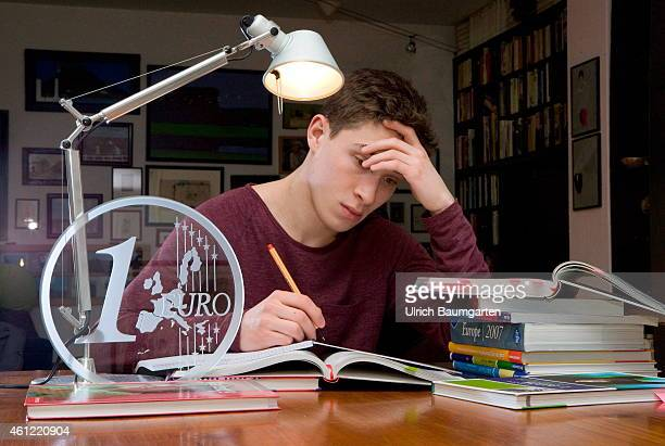 Learning student with textbooks and a 1 Euro coin made of glass Symbol photo on the topics study scholarship study costs credit university tuition...