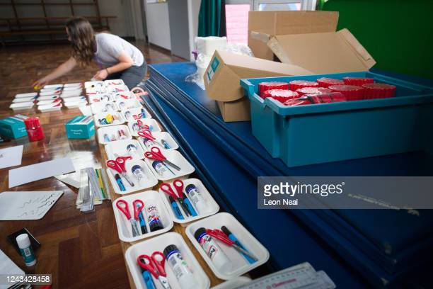 Learning Support Assistant Isabel Freeman cleans and divides items for individual student stationary packs ahead of the return of more students from...