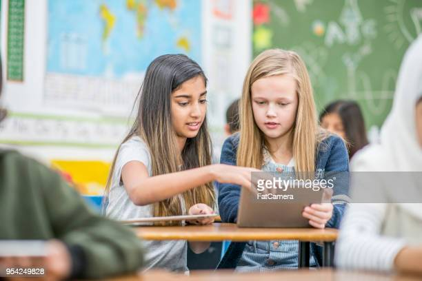 learning technology together - state school stock pictures, royalty-free photos & images