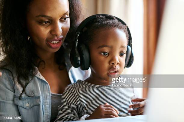 learning time meets quality time - surfing the net stock pictures, royalty-free photos & images