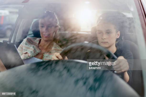 Learning to Drive, Alert, Nervous Woman Student Driver Taking Driving Education Lesson Test