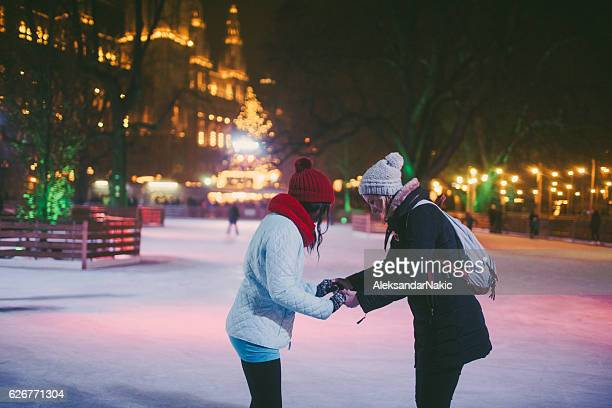 learning to ice-skate - town hall square stock pictures, royalty-free photos & images