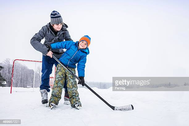 Learning to play ice hockey outside
