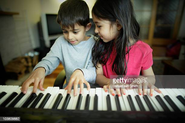 learning to play keyboard - electric piano stock photos and pictures