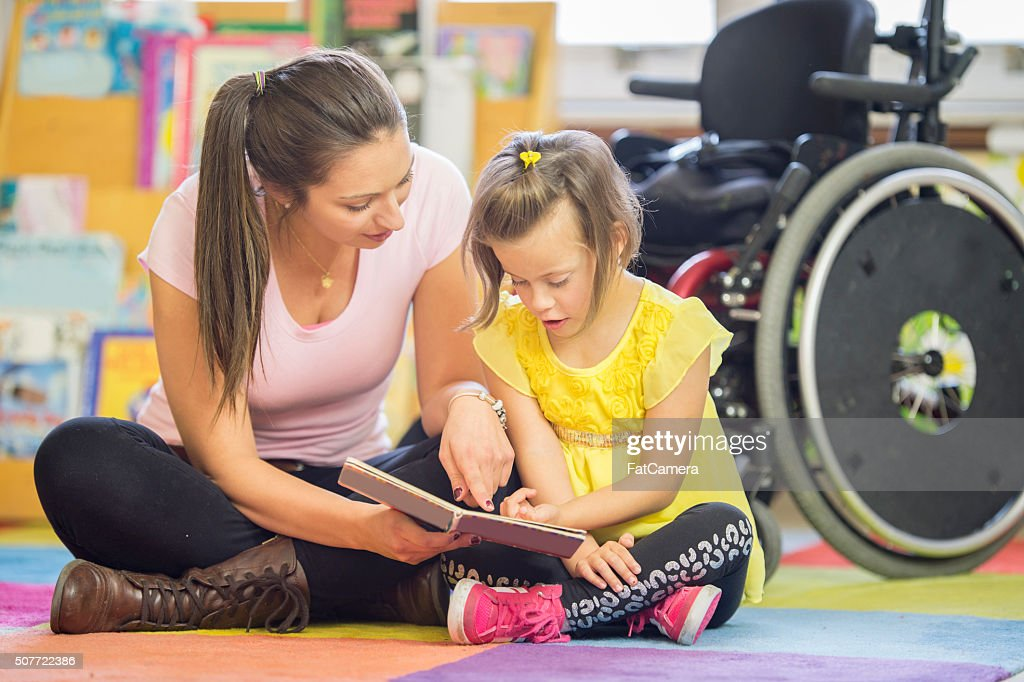 Learning to Read Together : Stock Photo