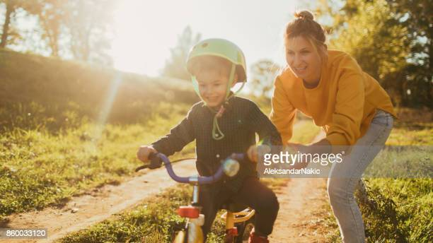 learning to ride a bicycle - springtime stock pictures, royalty-free photos & images