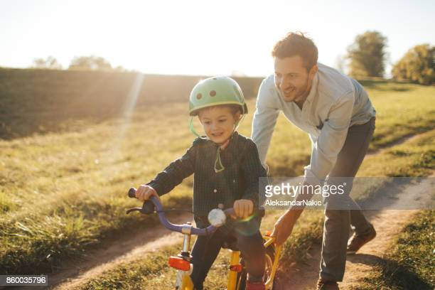 learning to ride a bicycle - prop stock photos and pictures