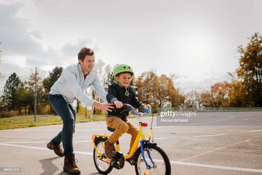 Learning to ride a bicycle : Stock Photo