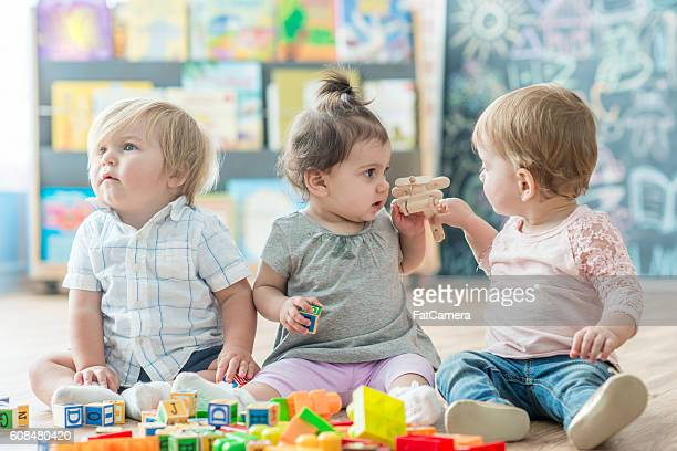 learning to share - preschool building stock pictures, royalty-free photos & images