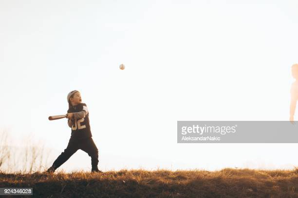 learning to swing a bat - sports bat stock pictures, royalty-free photos & images