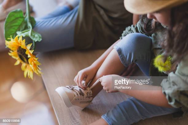 learning to tie shoelaces - shoelace stock pictures, royalty-free photos & images