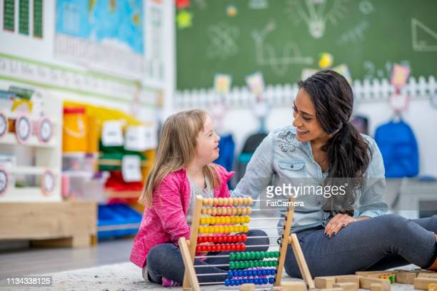 learning to use an abacus - disability stock pictures, royalty-free photos & images