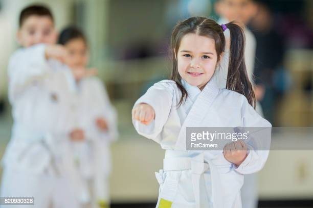 learning together - taekwondo kids stock photos and pictures