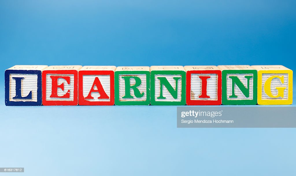 Learning - Wooden letter blocks : Stock Photo