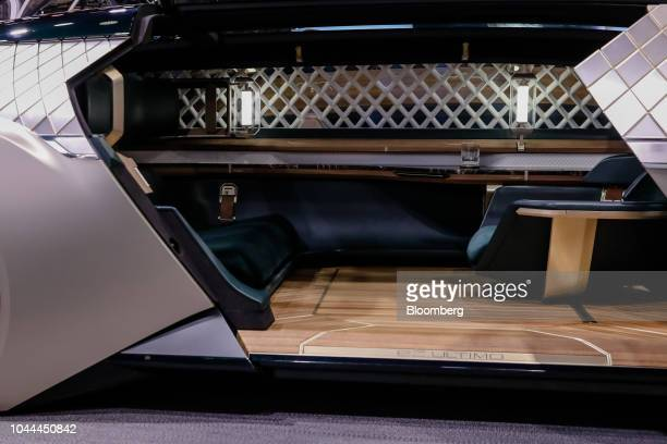 A leather armchair and wood paneling sit inside a Renault SA EZUltimo allelectric autonomous automobile during the Paris Motor Show in Paris France...