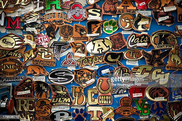 Leather badges with various logos are adhered to the side of one of the machines at the Wilson Football Factory in Ada Ohio on Wednesday August 28...