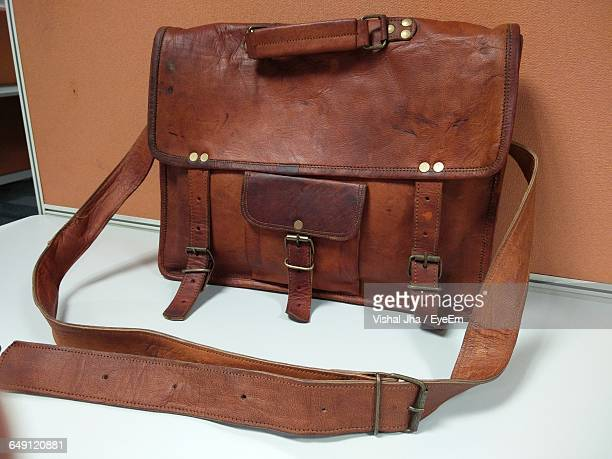 Leather Bag On Table Against Wall
