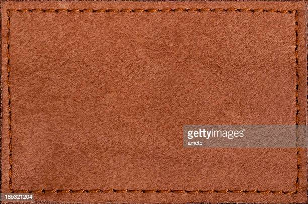 leather blank jeans label - brown jeans stock photos and pictures