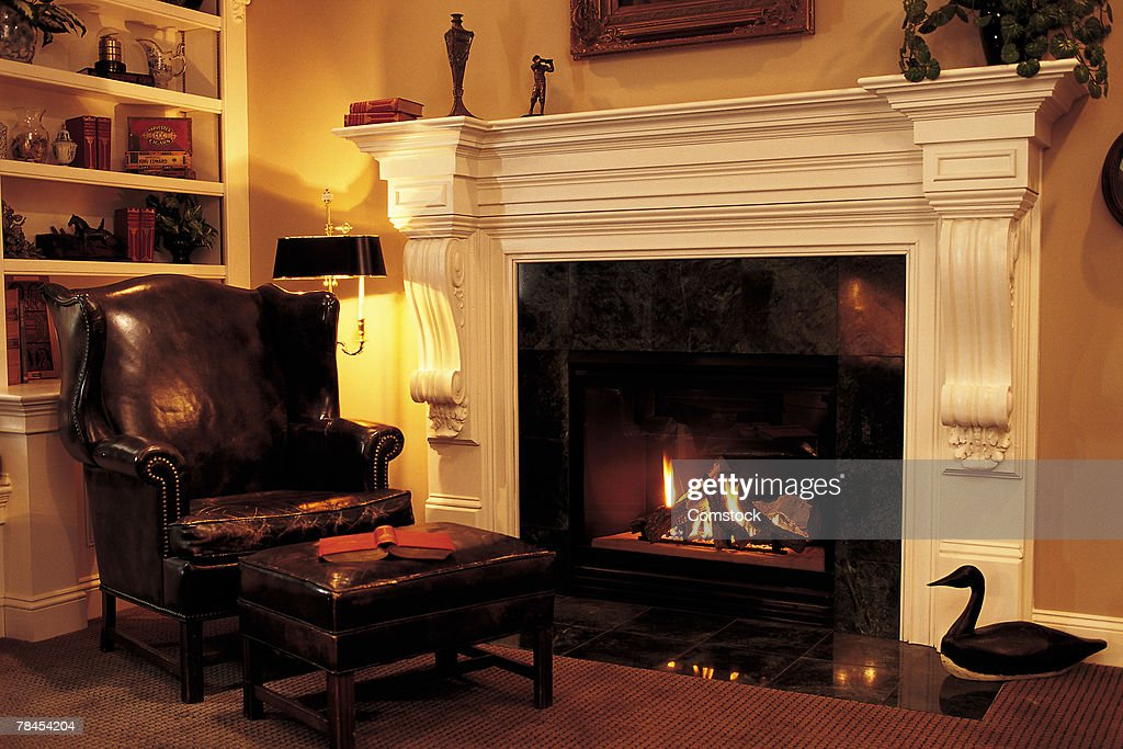 Leather Chair In Front Of Fireplace : Stock Photo
