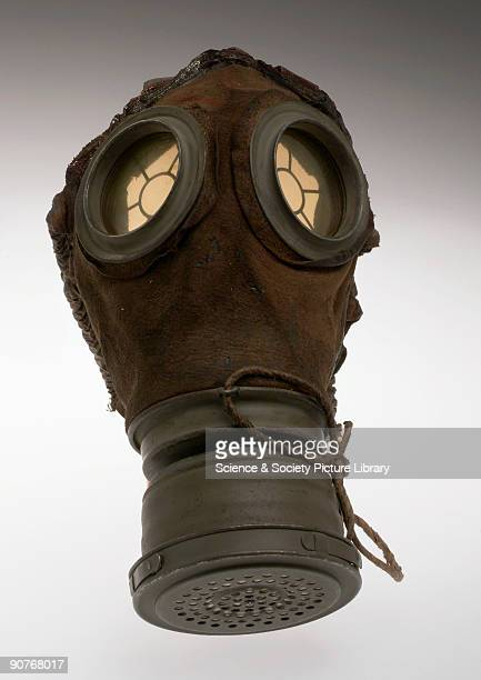 Leather gas mask with plastic eyepieces and steel fittings