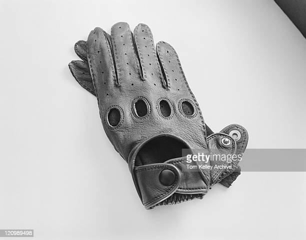 Leather gloves on white background, close-up