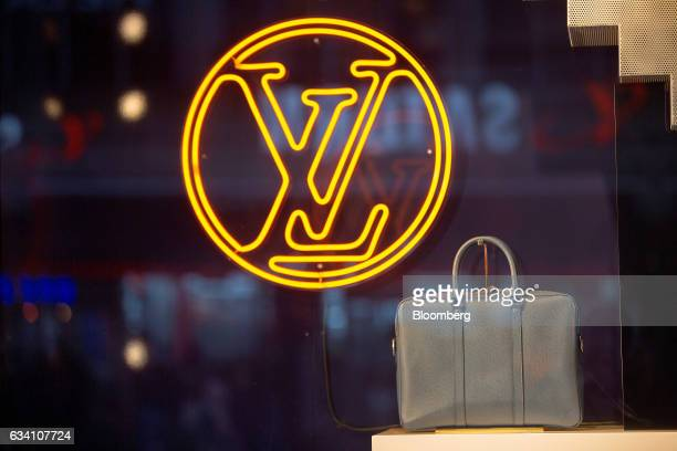 9755be0603e5 A leather handbag sits in the window display of a Louis Vuitton luxury  goods store operated
