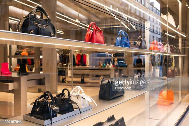 Leather handbags in the window display of a Balenciaga SA luxury goods store, operated by Kering SA, in Paris, France, on Wednesday, Oct. 21, 2020....