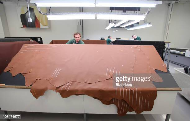 Leather hide is measured for use in the interior of automobiles at the Volkswagen AG Bentley factory in Crewe UK on Tuesday Nov 2 2010 Bentley...