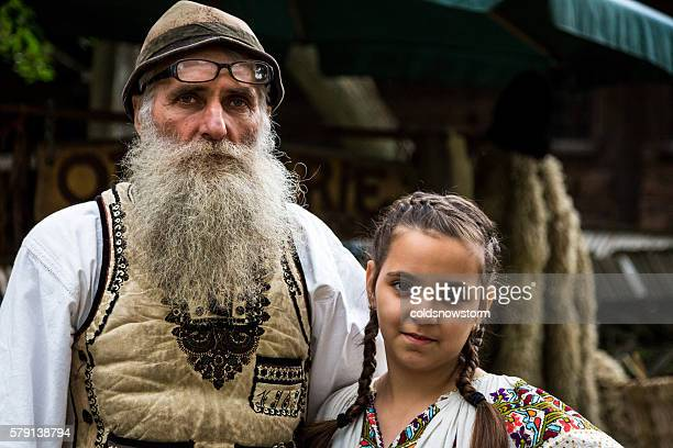 Leather Maker and his Daughter in Traditional Clothing, Bucharest, Romania