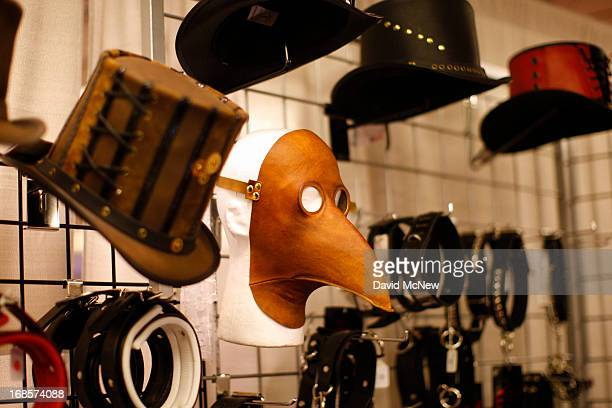 Leather masks and hats are displayed for sale in the exhibit hall of the domination convention DomConLA in the evening hours of May 10 2013 in Los...