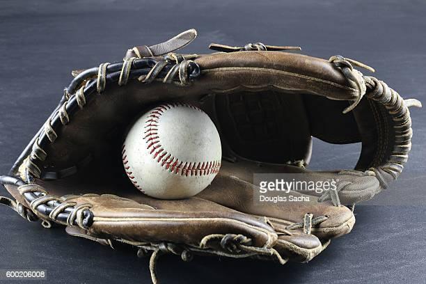 Leather Mitt and Baseball game equipment
