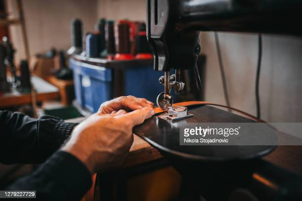 leather production, belt - leather belt stock pictures, royalty-free photos & images