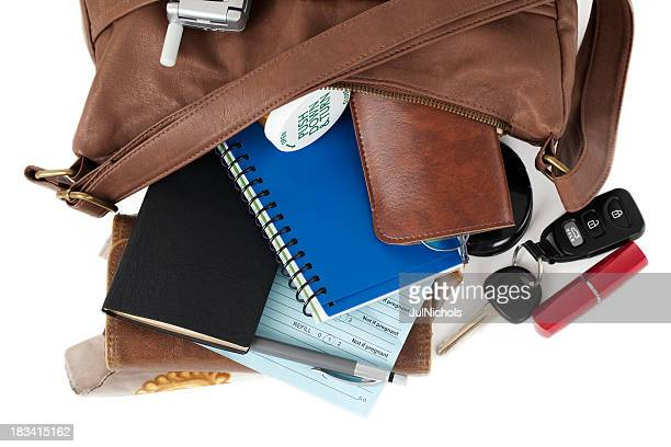 leather purse: spilling necessary items - leather purse stock pictures, royalty-free photos & images