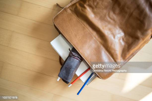 leather rucksack with paper and pencils - pencil case stock pictures, royalty-free photos & images