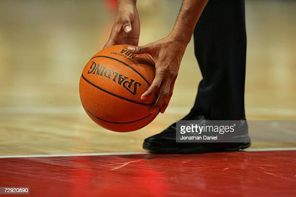 A leather spalding basketball is picked up by a referee during a stop in play between the Chicago Bulls and the Phoenix Suns January 2 2007 at the...