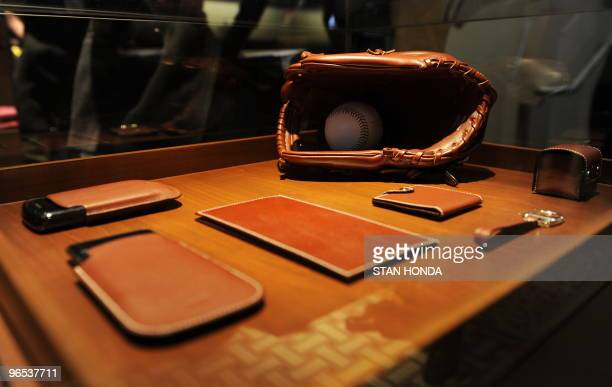 Leather specialty goods including a baseball glove are on display at the Hermes Man On Madison store February 9 during the opening of the store in...
