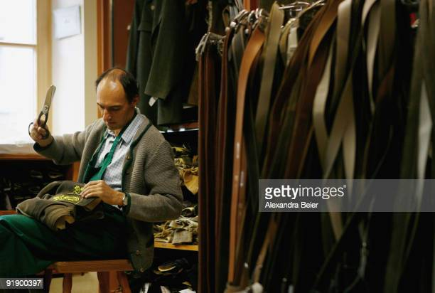 Leather tailor Franz Stangassinger crafts traditional Bavarian Lederhosen pants in his workshop on October 14 2009 in Berchtesgaden Germany The...