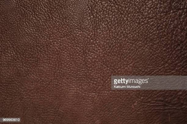 leather texture background - braun stock-fotos und bilder