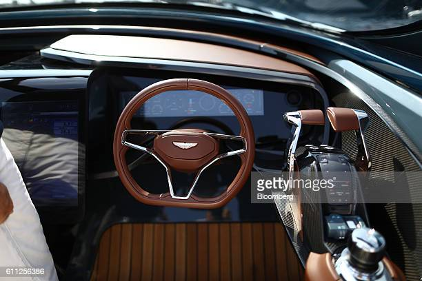 Leather trimmed carbon fiber controls sit in the cockpit of an Aston Martin AM37 luxury powerboat built by Quintessence Yachts during the Monaco...