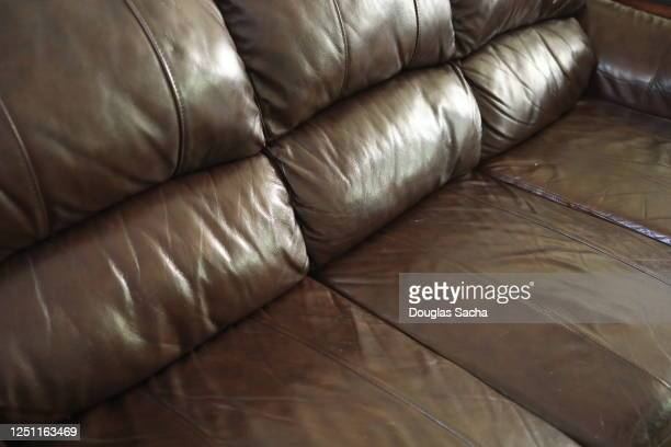 leather upholstered lounging sofa/couch - two seater sofa stock pictures, royalty-free photos & images