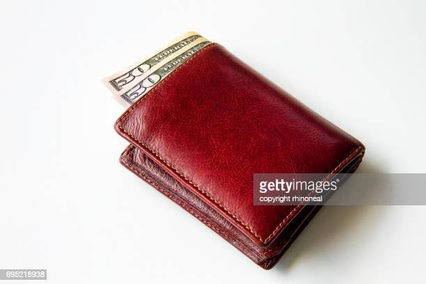 Leather wallet containing dollars