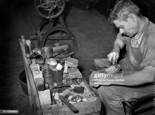 Leather, which forms the Heel, is applied in Layers and is filed down for accurate shaping, Boot Shop, Alpine, Texas, USA, Russell Lee, U.S. Office...