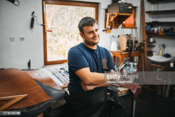 leather workshop owner - leather belt stock pictures, royalty-free photos & images