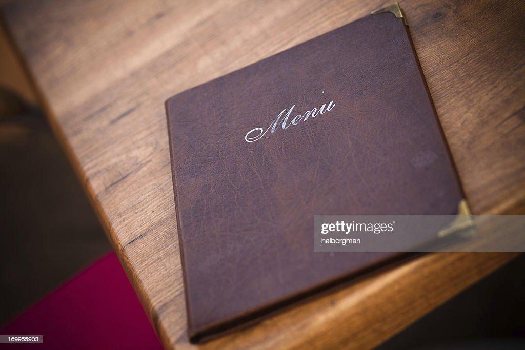 Leather-Bound Menu at European Cafe : Stock Photo